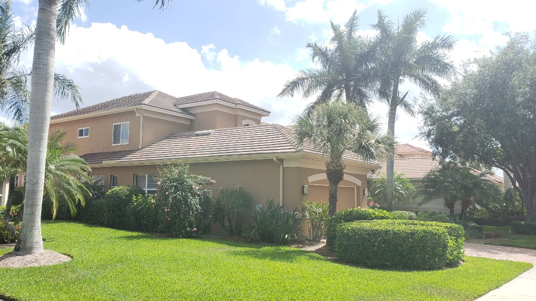 Naples, FL - A beautiful new roof installed by Halo Roofing in Pelican Marsh. An Eagle flat concrete Village Blend tile matches the color of this house perfectly and provides peace of mind to the customer with hurricane season quickly approaching!
