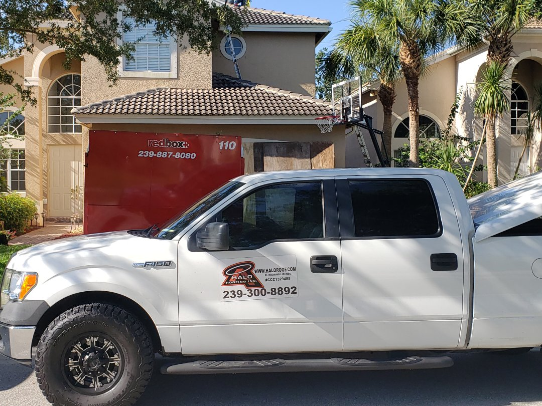 Naples, FL - Starting a new roof removal and replacement in Saturnia Lakes. Driveway, garage doors, and ac protected from falling debris to ensure a clean and pain free Roofing replacement