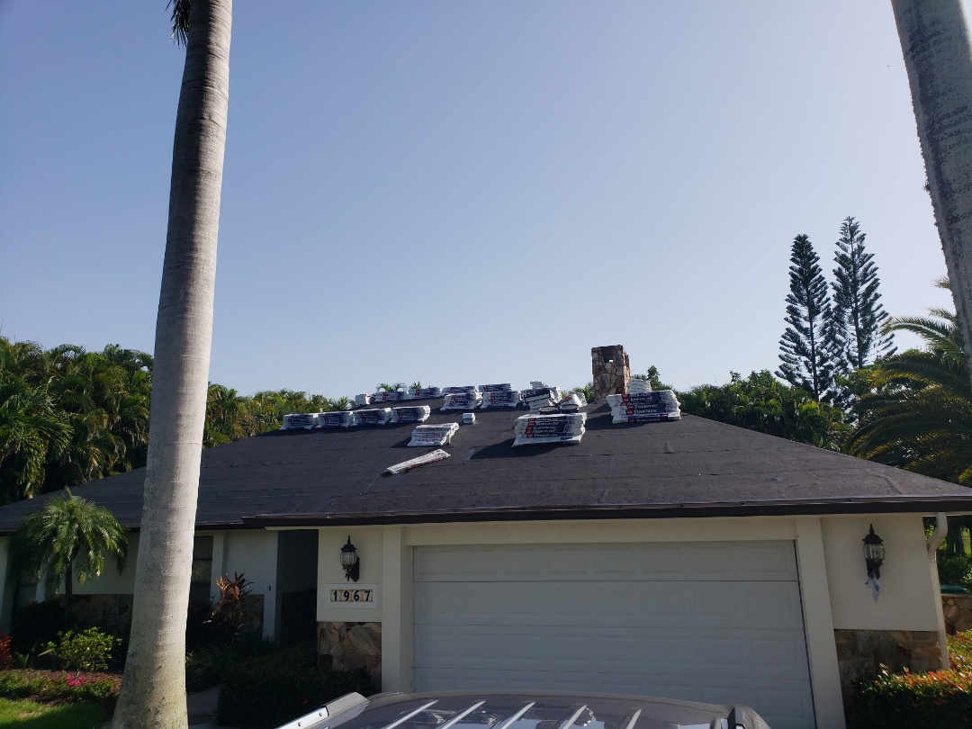 Naples, FL - Ice and water shield around entire roof not only gives extra  protection but also helps reduce insurance rates with a new wind mitigation report because it is a SWR product. GAF shingles are loaded on roof and we await Collier County inspection so we can finish this job in Imperial Golf Estates in Naples!