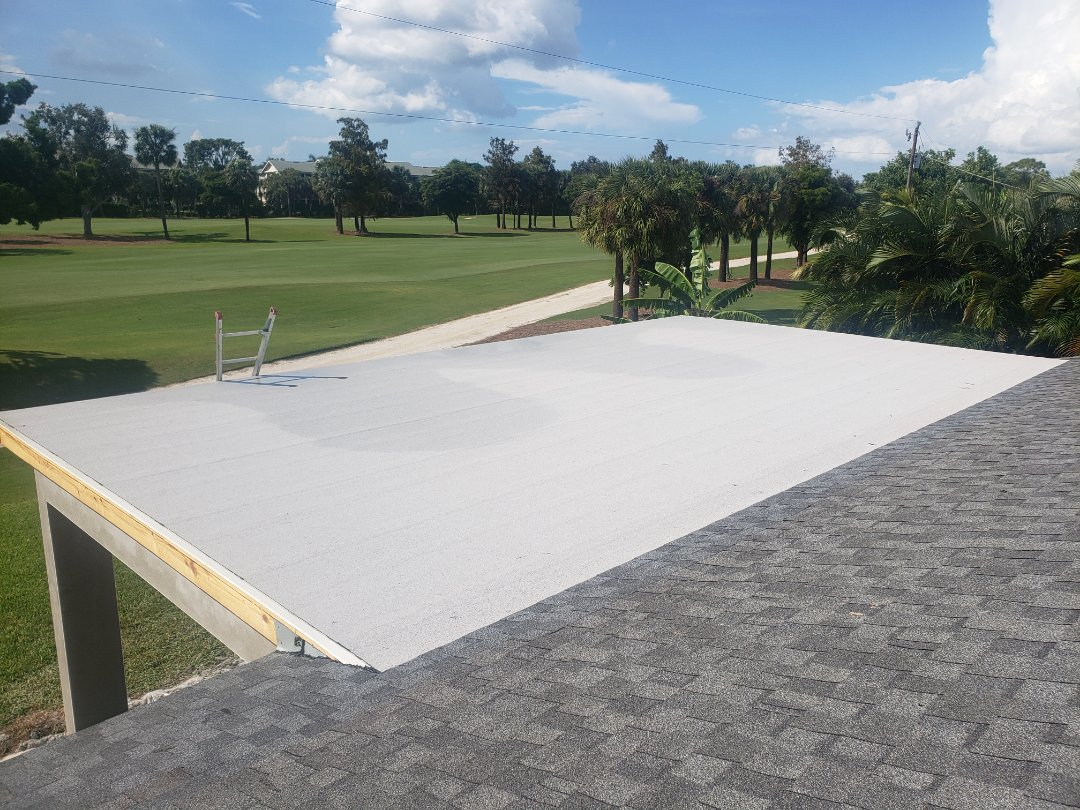 Naples, FL - This new addition in Naples was finished off with a new Flintlastic two ply self-adhered flat roofing system. Valley metal and new shingles were installed between the old roof and new roof to make sure that the system is water tight! A roller was used on both layers to make sure there are no bubbles!