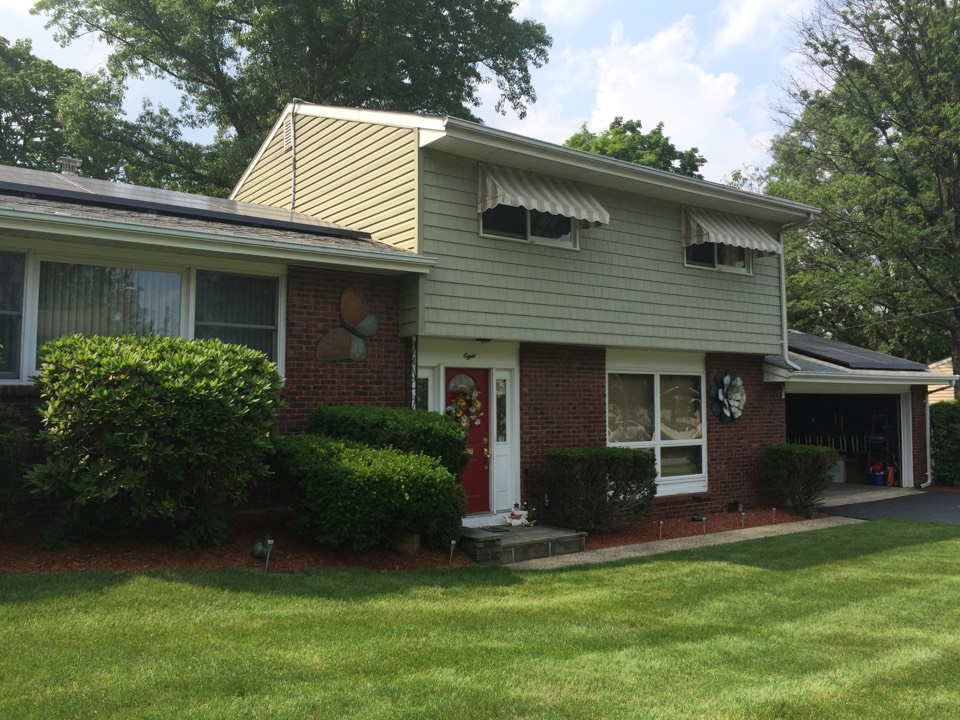 East Brunswick, NJ - When choosing your siding, long term durability and beauty are imperative.  This home was sides 6 years ago with Certainteed Cedar Impressions and Monogram Dutch lap siding.  The cypress color tends it like it did with no sun bleaching.   The interior is protected with solution dyed Sunbrella SunCatcher awning fabrics.  A photo of the back of the home would show homeowners lounging and escaping from the sun under their Eclipse lateral arm retractable awning!