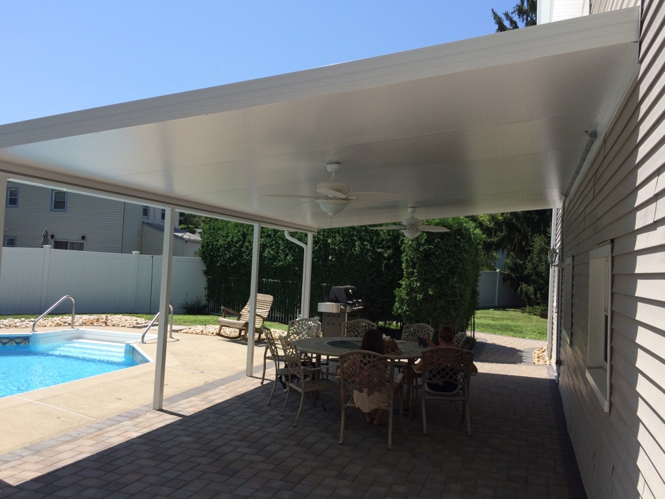 "East Brunswick, NJ - Do you lack shade on a sunny, 95 degree July day?  These folks don't!  This Elite Aluminum 6"" patio cover spans 24' and extends 15' on projection.  Cooled by two fans, the temperature is reduced more than 20 degrees.   (The roof meets and exceeds all code wind and load requirements)."