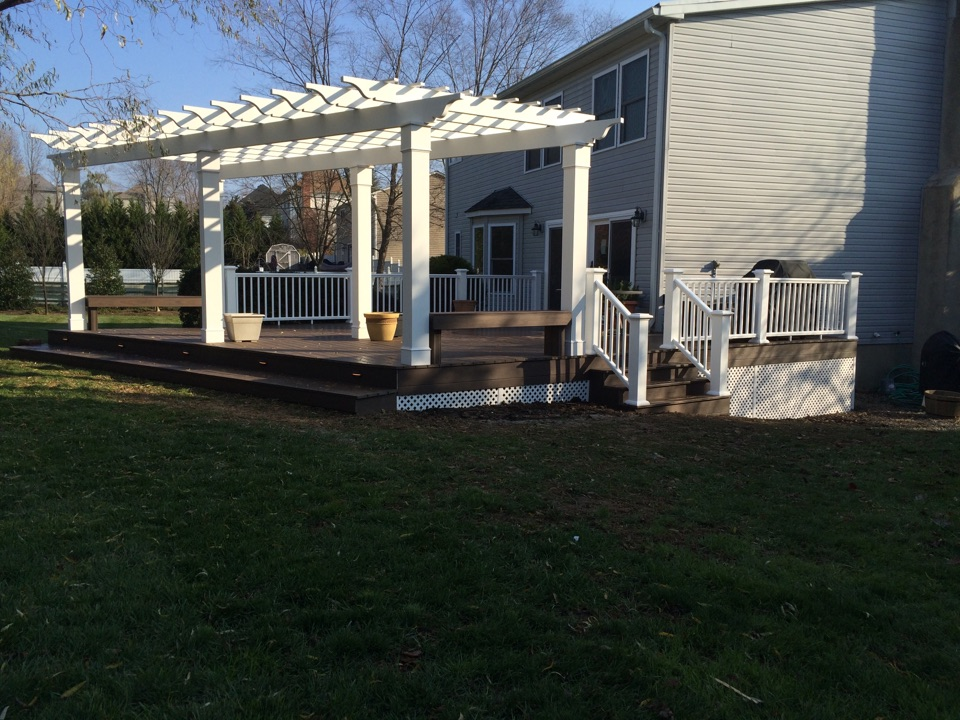 Monroe Township, NJ - Intex Pergola complimented with Azek XLM composite decking and Azek Premier composite railings by Valiant Home Remodelers!