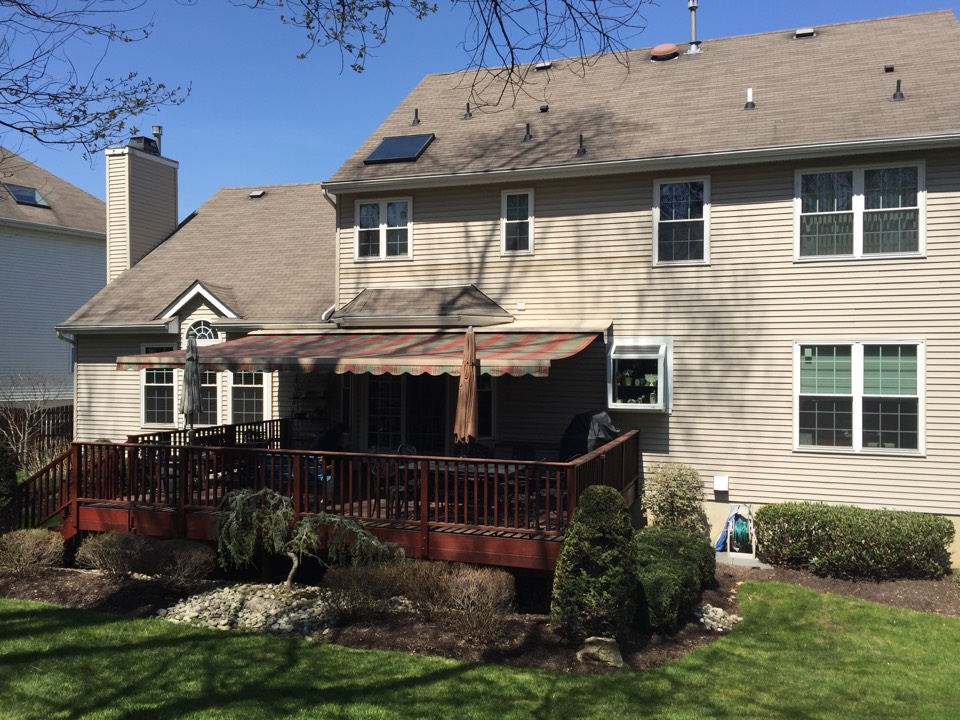 East Brunswick, NJ - Another winter cover removed and another, perfectly operating Eclipse Shading System. This one a Total Eclipse 24' x 13' retractable motorized awning.  It works on and offset and has Lunar Lights.  Installed 2005 and still working like a champ.  In background, are Sunrise Manufacturing double hung windows with low-e and argon-filled insulated glass.