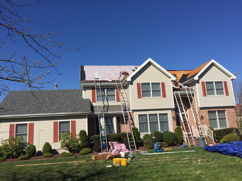 Monroe Township, NJ - Installing a complete Owens Corning SureNail roofing system to protect this 20 year old colonial home.  Taking proper safety precautions, we are installing estate gray TruDefinition Duration fiberglass shingles.  Note to complete the system, were using OC underpayment installing ice shield per Mfgr requirements.  Project should be completed in two days w no harm to landscaping, lawn or home.