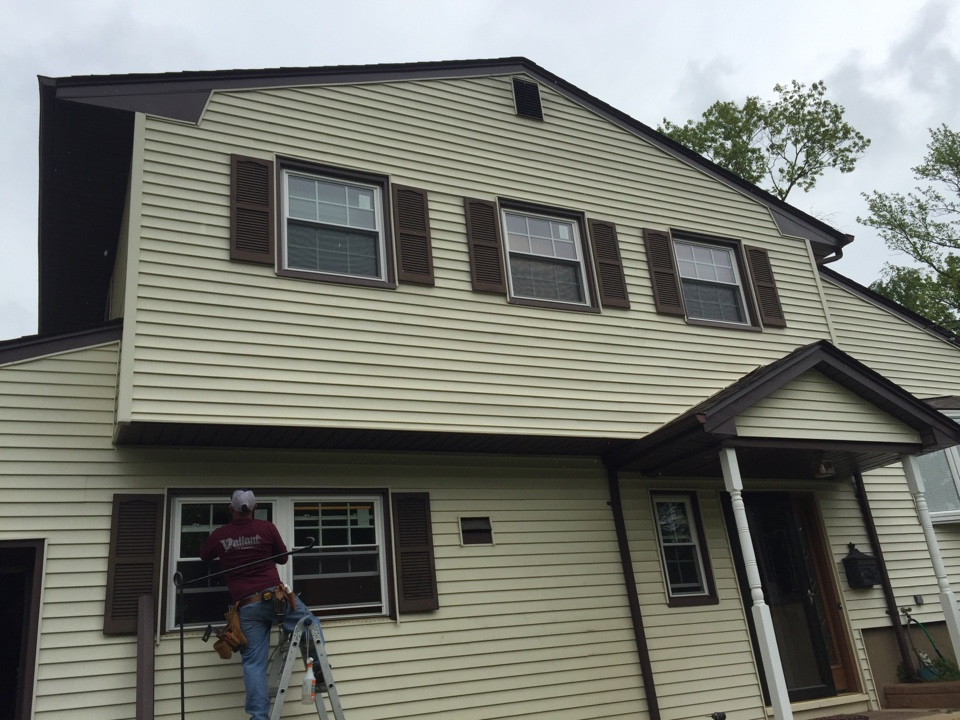 East Brunswick, NJ - Finishing the final touches on a Sunrise Windows, Sunrise Series full frame installation.  Premium insulated glass with low-e and argon filled IGU.   Valiant Home Remodelers installation includes full replacement of interior casing with clear pine urethaned to a crisp finish.  Nothing beats a completed project