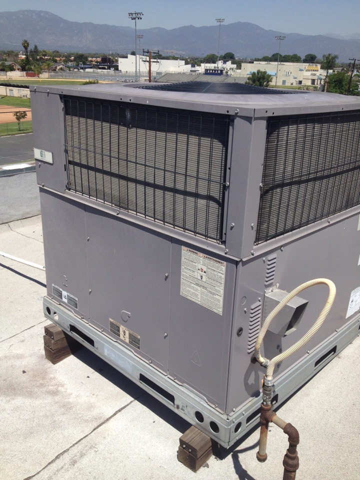 South El Monte, CA - Performing maintenance service on day and night gas electric rooftop AC and heating unit