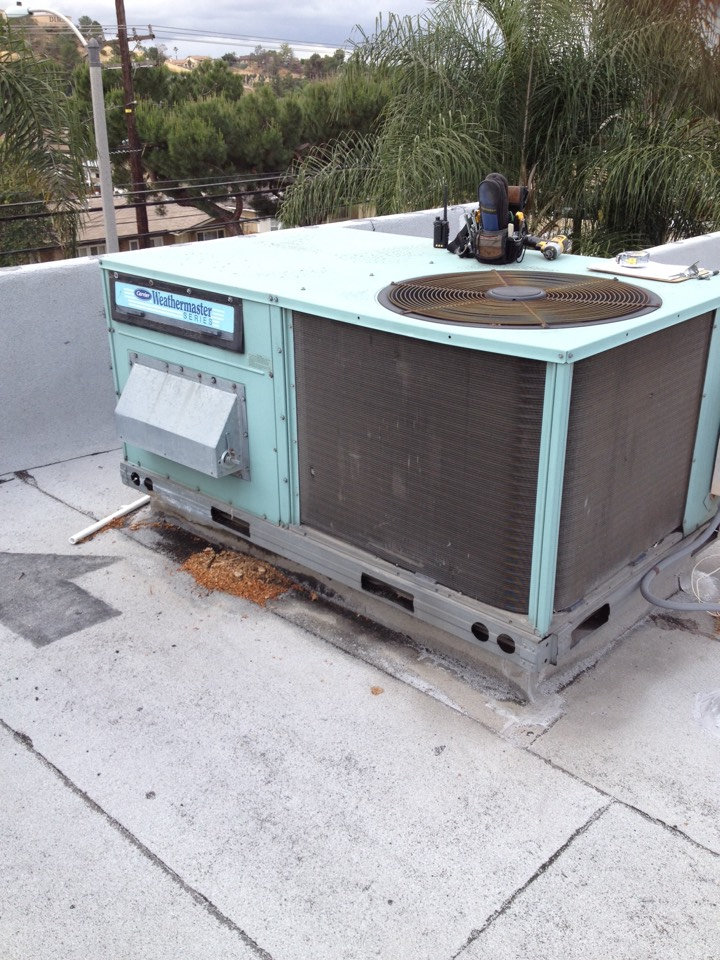 San Dimas, CA - Performing maintenance service on three package units