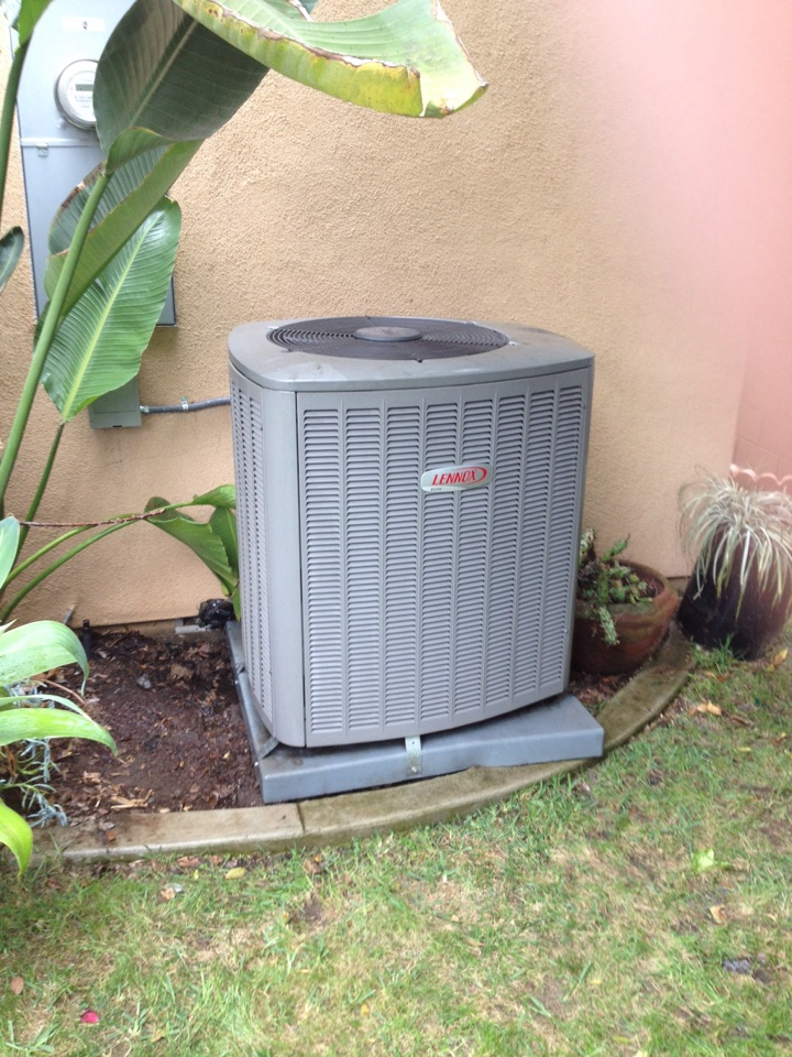 San Dimas, CA - Performing maintenance service on Lenix heating and air-conditioning system