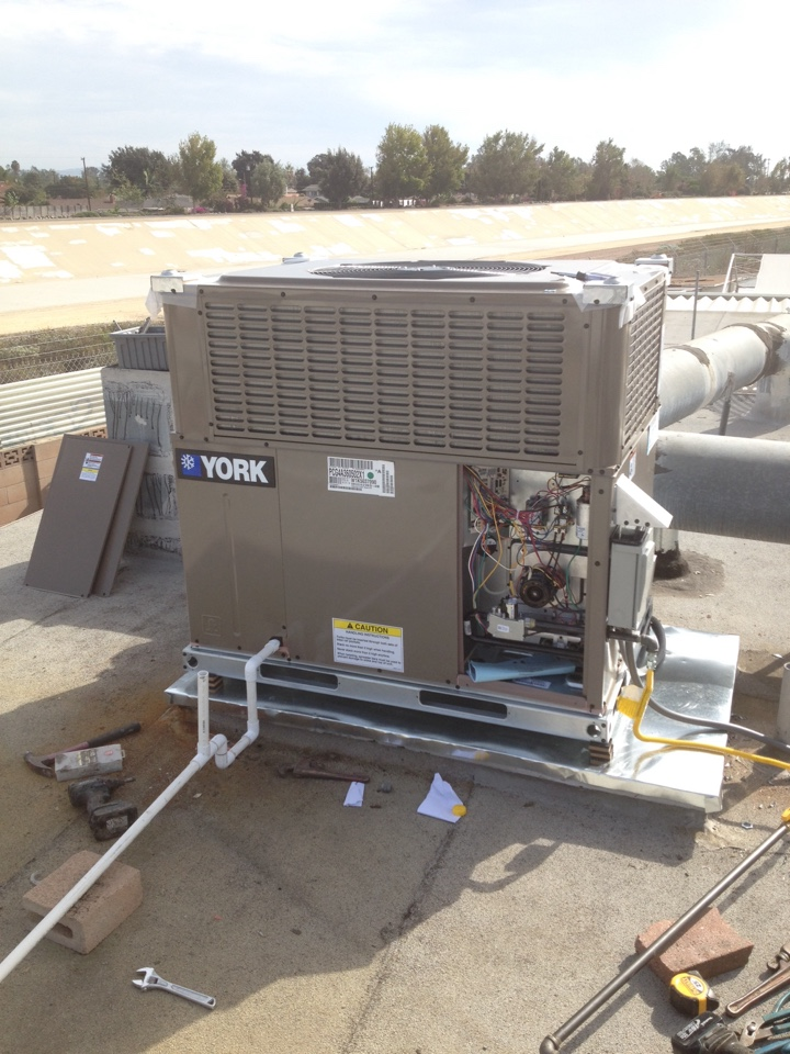 Santa Ana, CA - Installing new 3 ton YORK package air conditioning unit on top of the roof
