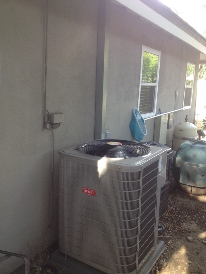 Glendora, CA - Performing maintenance service on Bryant heating and air-conditioning split system