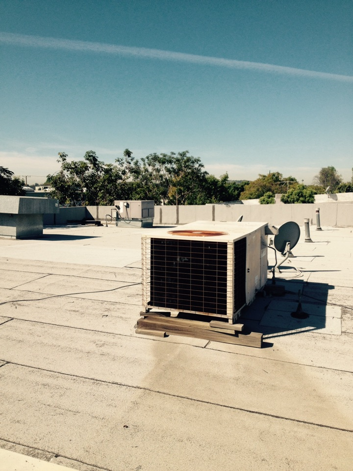 Pomona, CA - Performing maintenance service on three roof top heating and air-conditioning systems