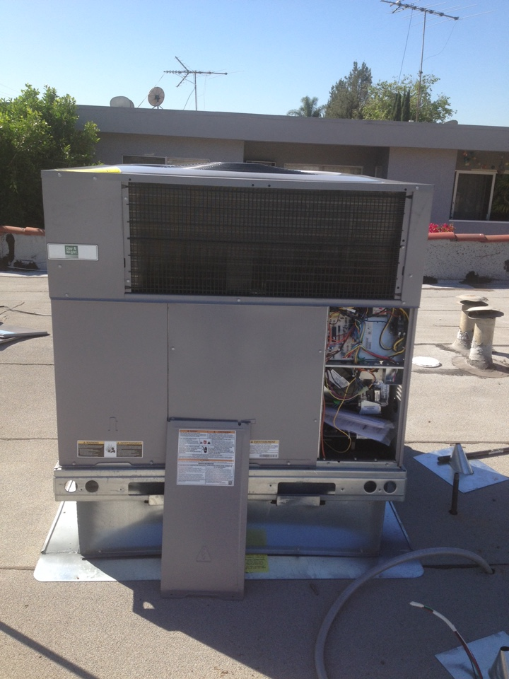 West Hollywood, CA - Installing new DAY & NIGHT air conditioning & heat package unit on the roof.