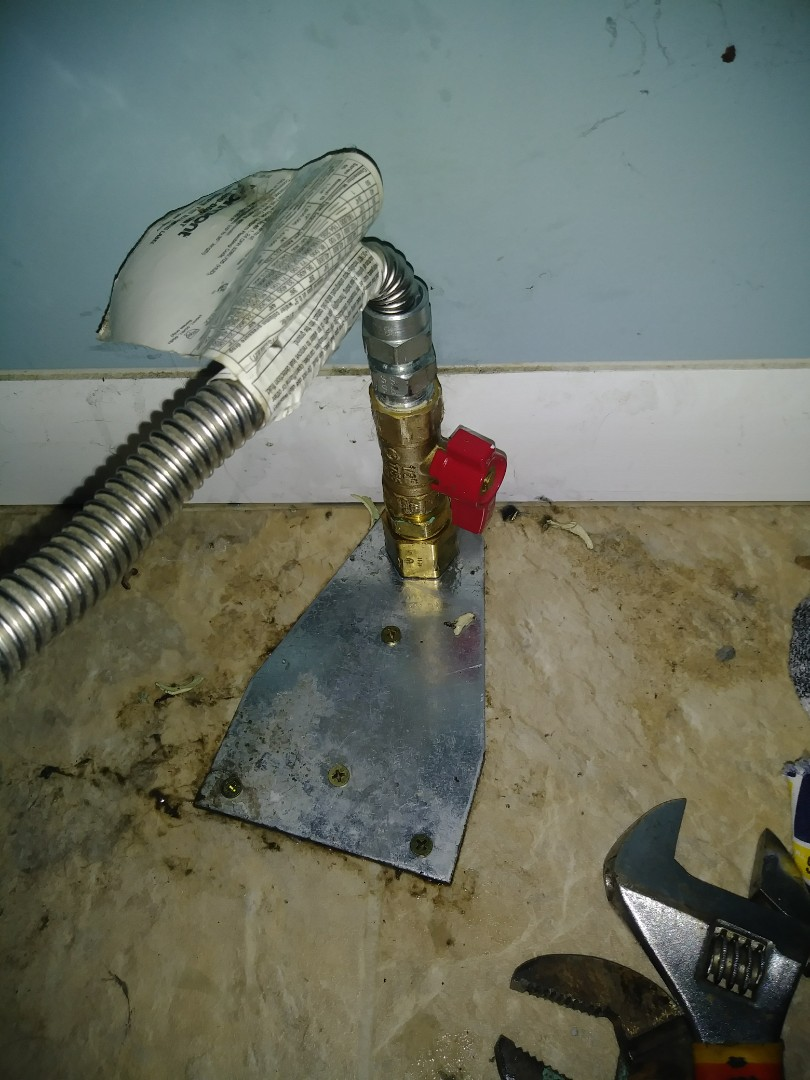 Lansing, MI - Gas leak repair on dryer gas bracket