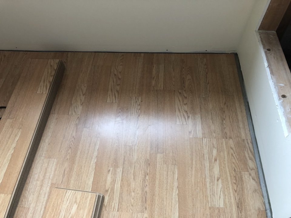 Holland, MI - Install new laminate floor in the living room. After apartment water damage from broken supply line to the sink. Living room water restoration is completed.