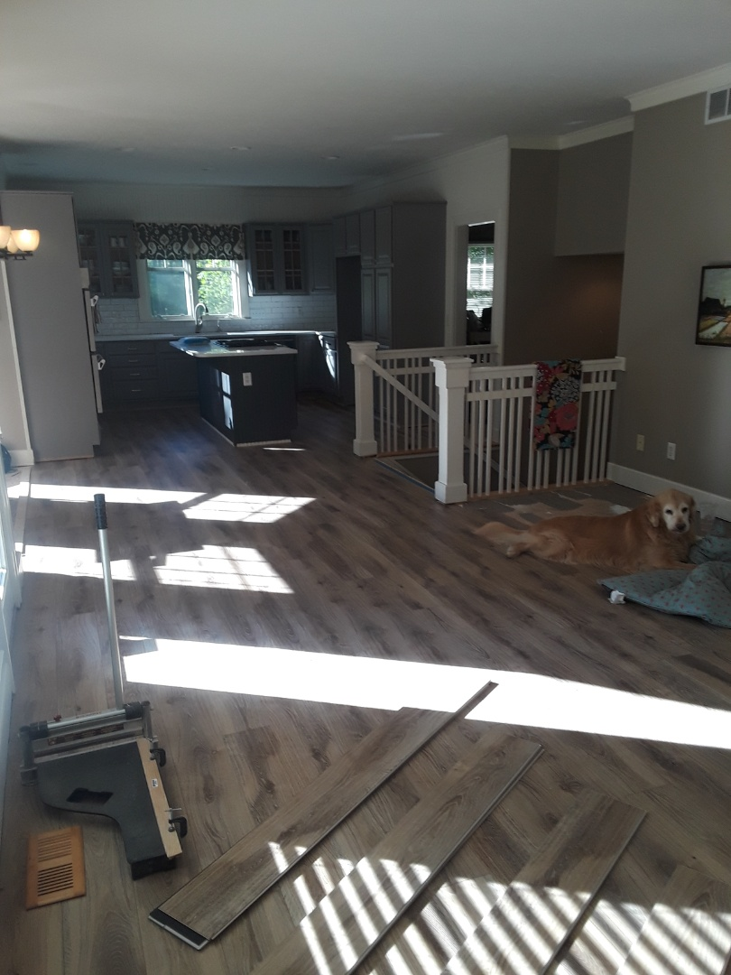 Cannon Township, MI - Made good progress on the engineered floor.  The homeowners wanted to get the refrigerator out of the living room, so I worked a few extra hours to make that possible. I'm happy with my progress.