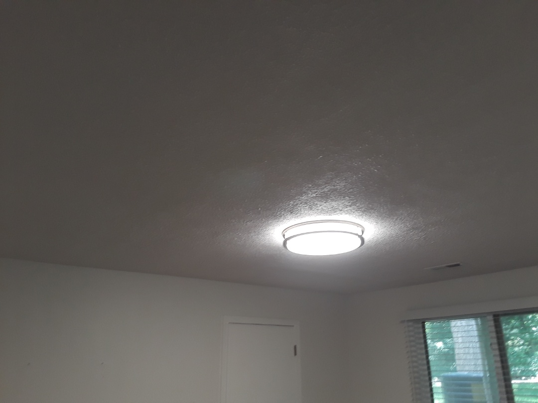 Hudsonville, MI - It's hard to tell from the picture but the ceiling is finished and everything is cleaned up.  The ceiling has been patched, textured (stomped), primed and painted.