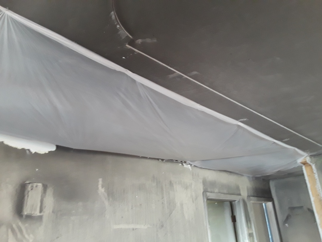 Grand Rapids, MI - Hanging plastic over damaged ceiling to keep all the benefits of the odor removing ozone machine contained