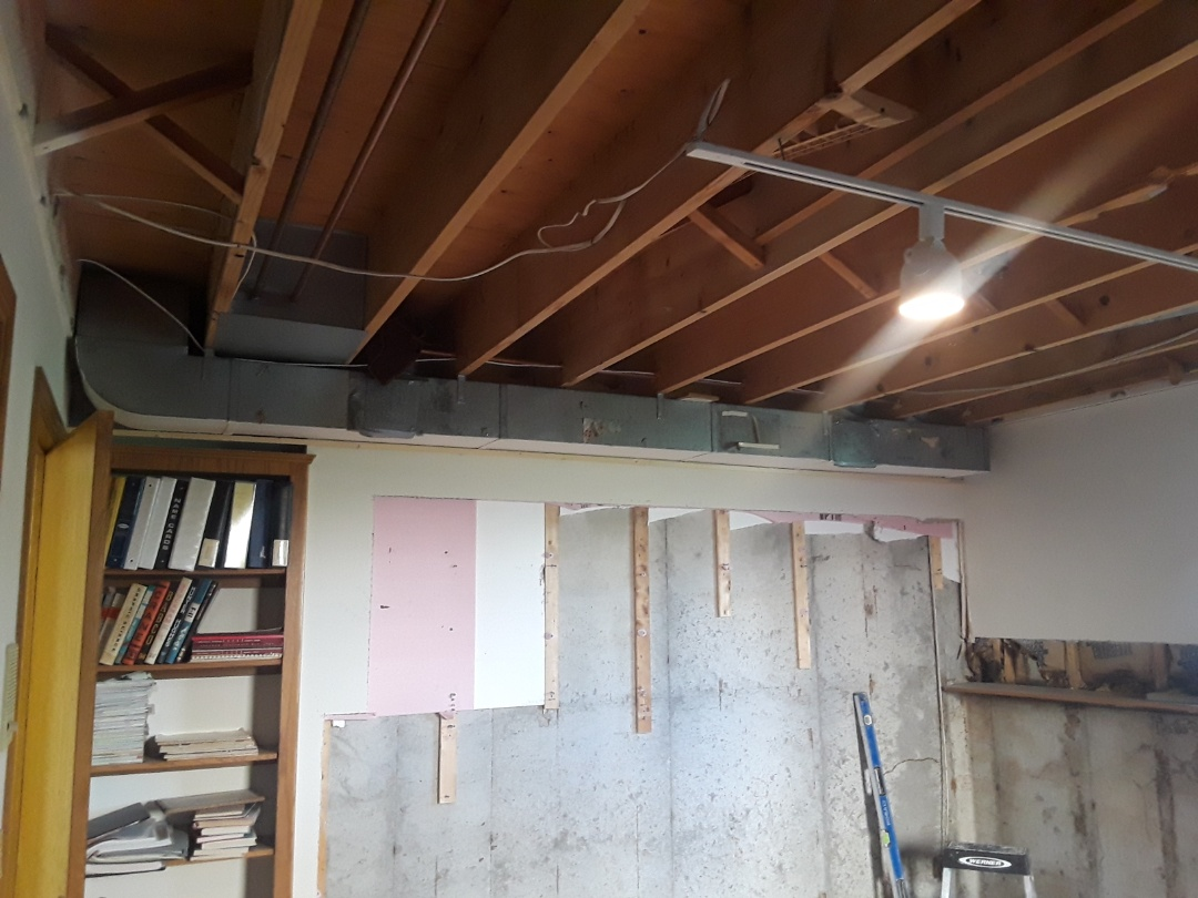 Georgetown Township, MI - While we are waiting for the concrete foundation to dry I'm gonna move the project along by building a bulkhead around the duct work and installing the ceiling grid.