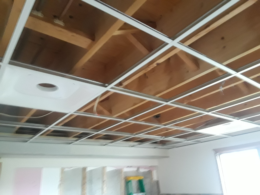 Georgetown Township, MI - Made good progress today. Installed the drop ceiling grid, the diffusers and relocated the can lights