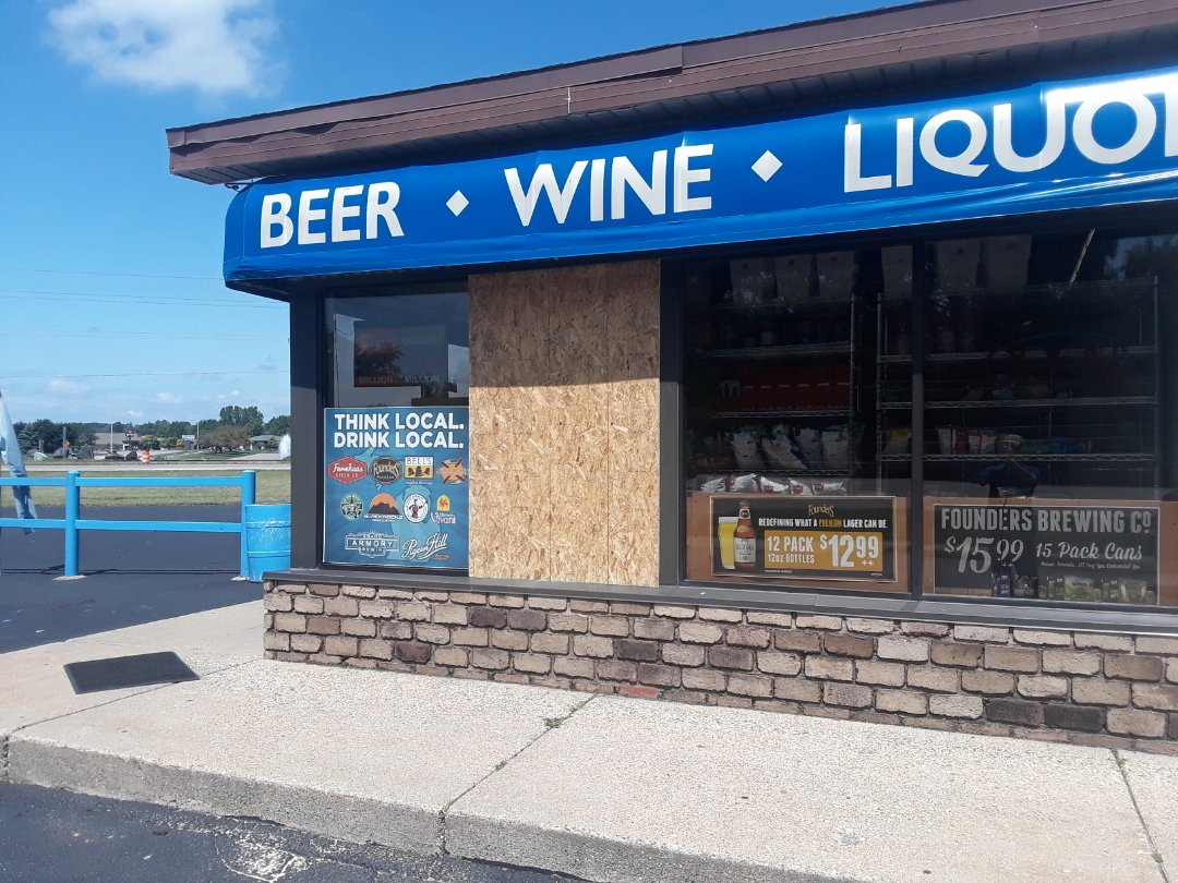 Georgetown Township, MI - Thieves broke a window to rob a local party store last night. I removed the large broken pane and boarded it up until the glazing (commercial windows) company can replace it