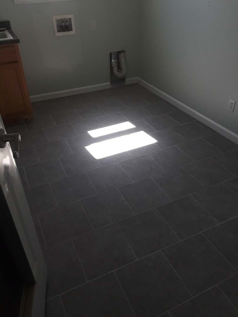 Allendale Charter Township, MI - Again, lousy picture, but the laundry room project is complete. I buffed the tile clean, installed the base molding, caulked, filled and touched up the paint.  The homeowners are very happy with the timeline and quality of the job ??