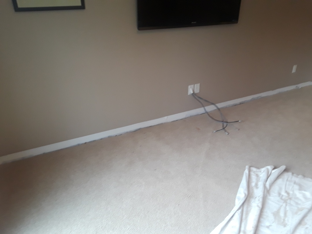 Grandville, MI - A foundation leak caused the basement carpet to get a little wet.  I removed the baseboard molding and tack strip. I also treated the cement slab, pad and carpet with antimicrobial spray