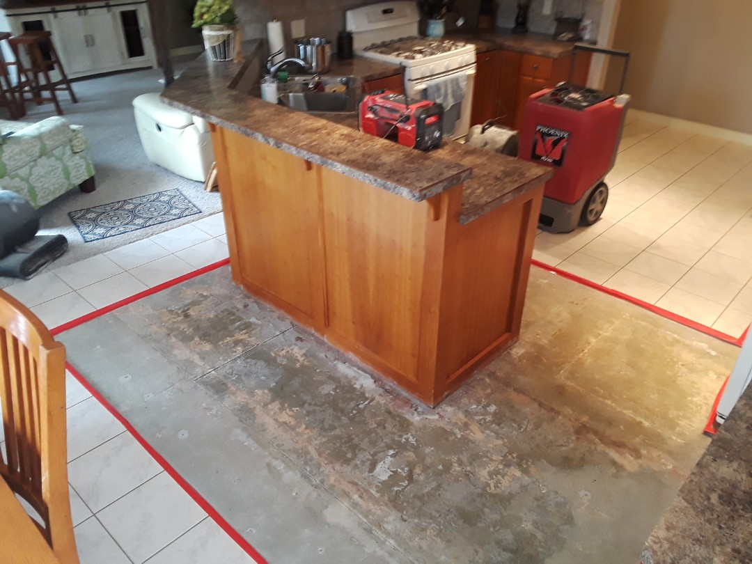 Hudsonville, MI - The dishwasher decided to spring a leak so I removed a vinyl plank floor that was over a ceramic tile floor.  After that I sectioned out about 60 sq/ft of tile and cement board. I then drilled holes in the toe kicks, taped of the tile edges (to alert of a trip hazzard) and set up a dehumidifier and 2 air moves.