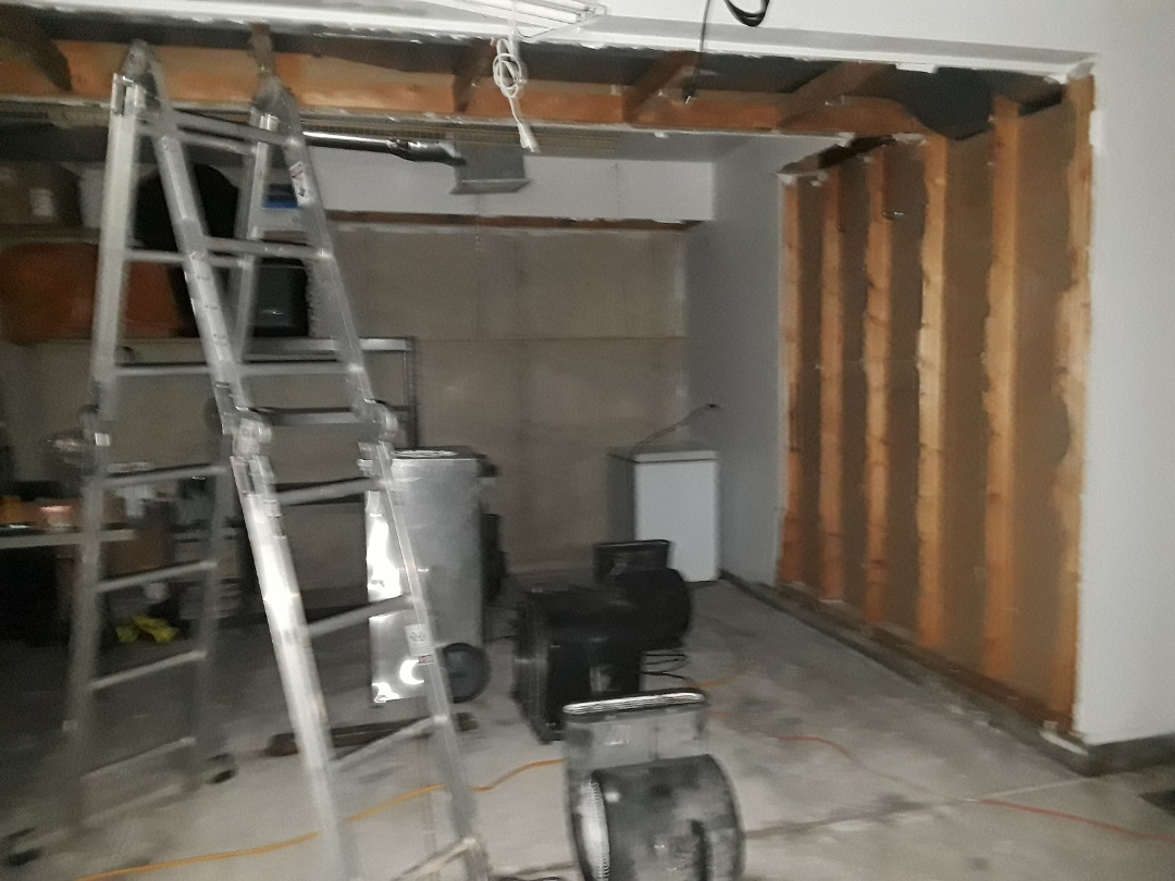Wyoming, MI - Most of the water from the broken supply line leaked into the garage. This is a picture taken after we removed the saturated and sagging drywall and set a dehumidifier and several air movers