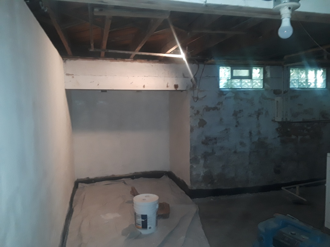 "Grand Rapids, MI - Almost have ""blockfiller"" primer finished. It's slow to apply, but fills in most of the divots, pits and holes found in old basement walls."