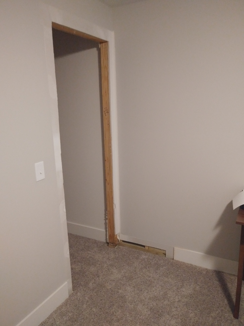 Hudsonville, MI - After the damaged door is removed. I also cut back some damaged baseboard. The drywall had a little bit of mold so I cut that away as well. Luckily there was none on the back
