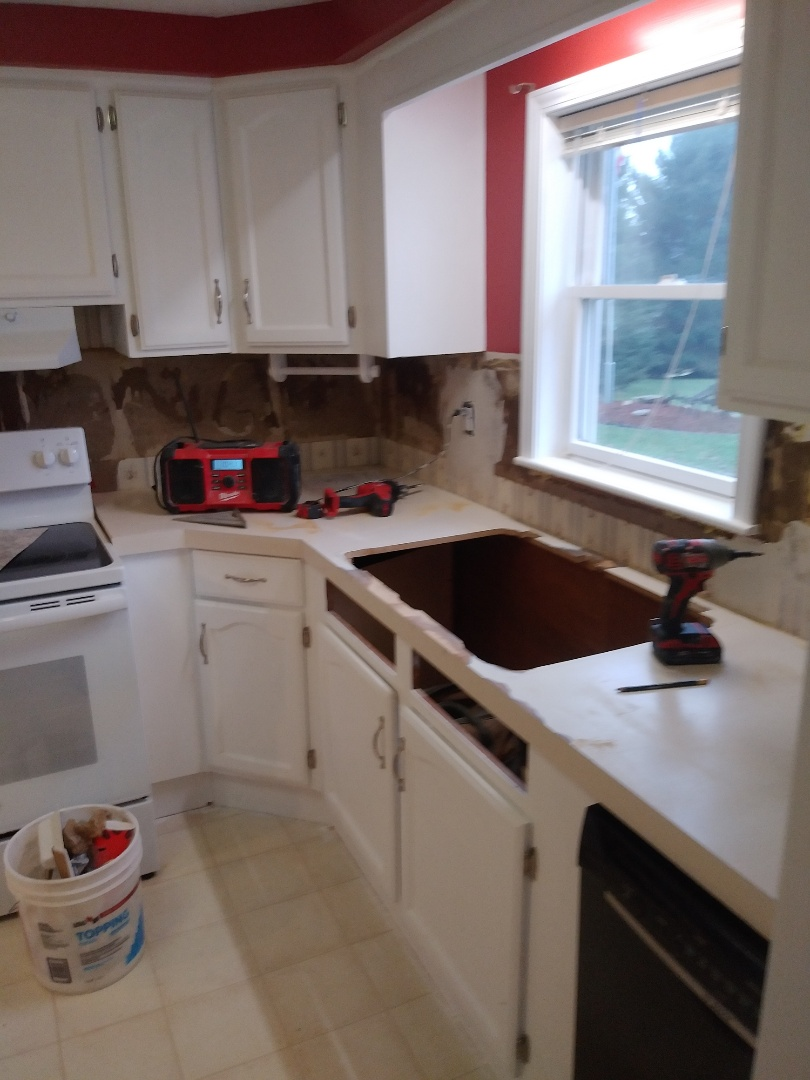 Middleville, MI - Just finished the prep work for applying new Formica and tile backsplash. Patched and sealed the drywall. Patched and sanded existing countertop. Removed old sink and modified opening to fit the new sink