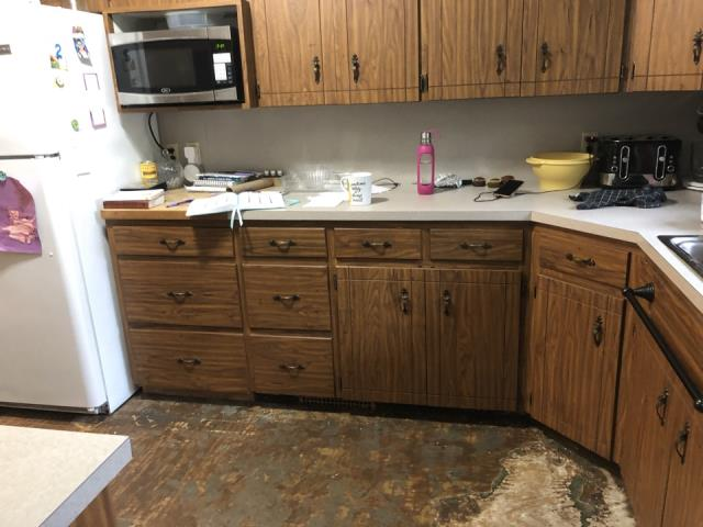 Coopersville, MI - Water damage to kitchen cabinets and sub floor damage.