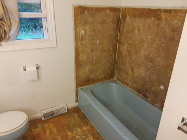 Grand Rapids, MI - water damage in this bathroom. Repairing floor and shower.