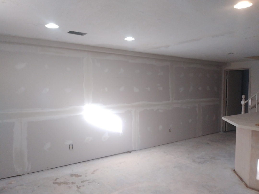 Hudsonville, MI - Built a bulkhead to cover a relocated pipe. Hung drywall. Installed corner bead and got a coat ot mud on.  Good day