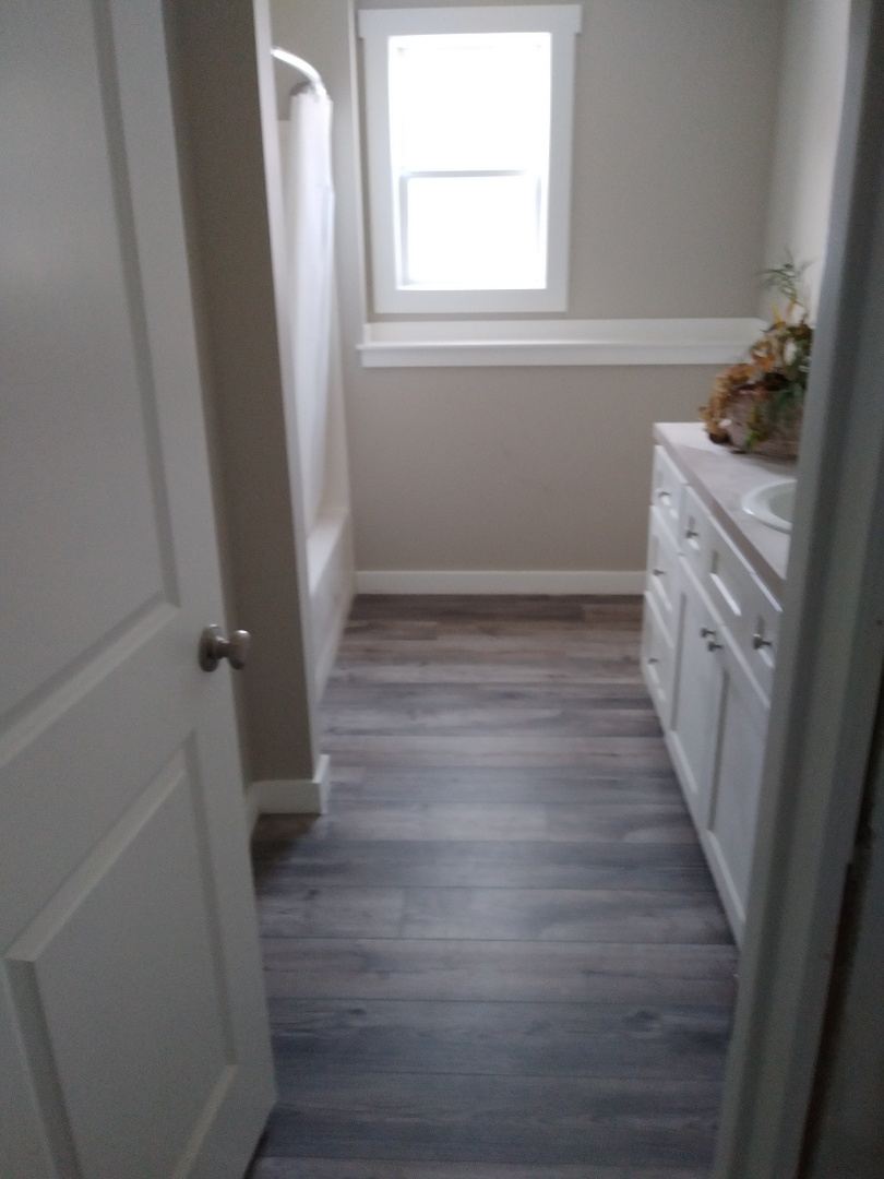 Walker, MI - Finished laying the floor in the bathroom