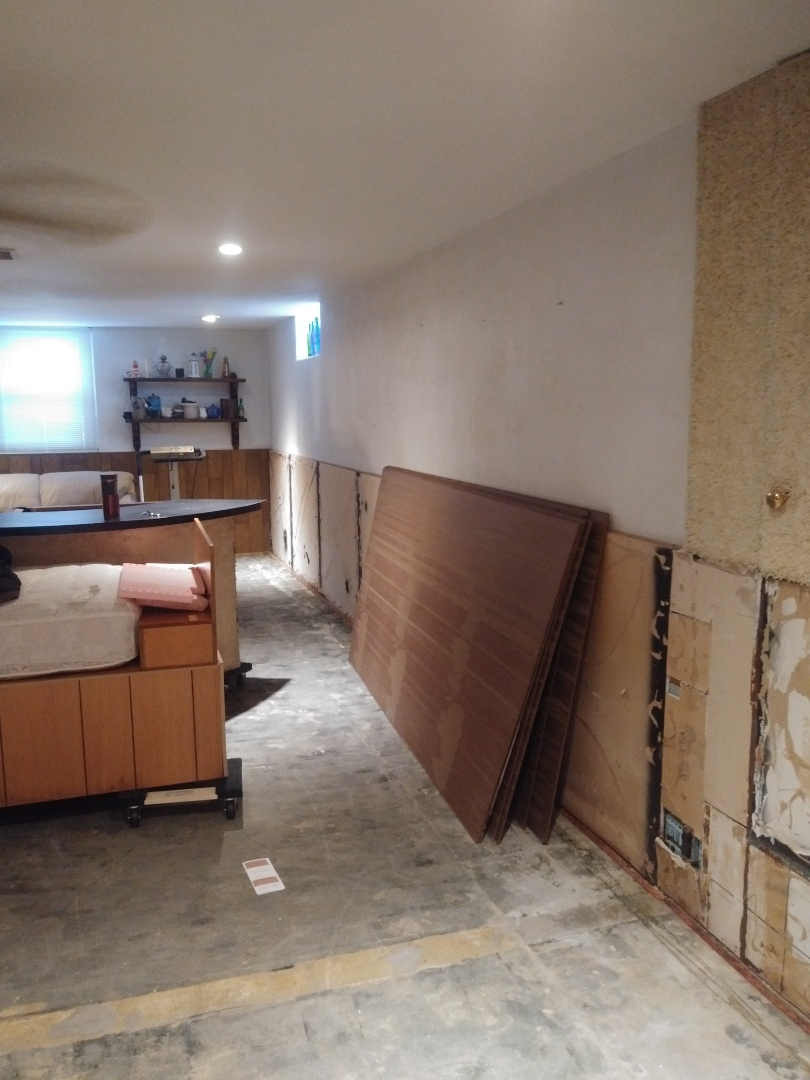 Grand Rapids, MI - Preparing to install new paneling due to a small basement flood