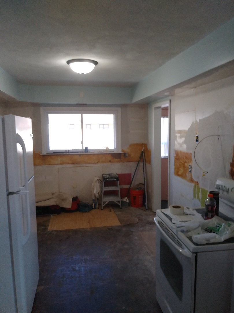 "Holland, MI - Moving forward. Patched the floor which was rotten out due to leaky plumbing. Relocated 2 outlets that would have been half covered by the new cabinets. Removed ""dead"" vent snd wiring. Hung drywall where necessary and applied 1 coat of mud."