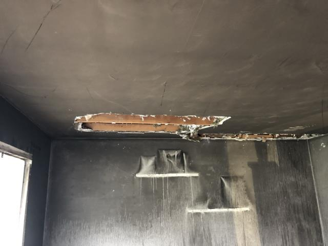 Grand Rapids, MI - Fire damage to the ceiling.
