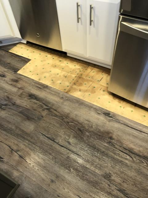 Grand Rapids, MI - Water damage to the kitchen floor.