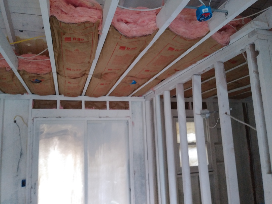 Grand Rapids, MI - Finished the wiring. Almost finished the insulation. Repaired a broken joist as well