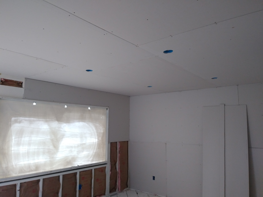 Grand Rapids, MI - Finished the insulation, repaired a broken joist, installed all the drywall on the ceilings and started on the walls