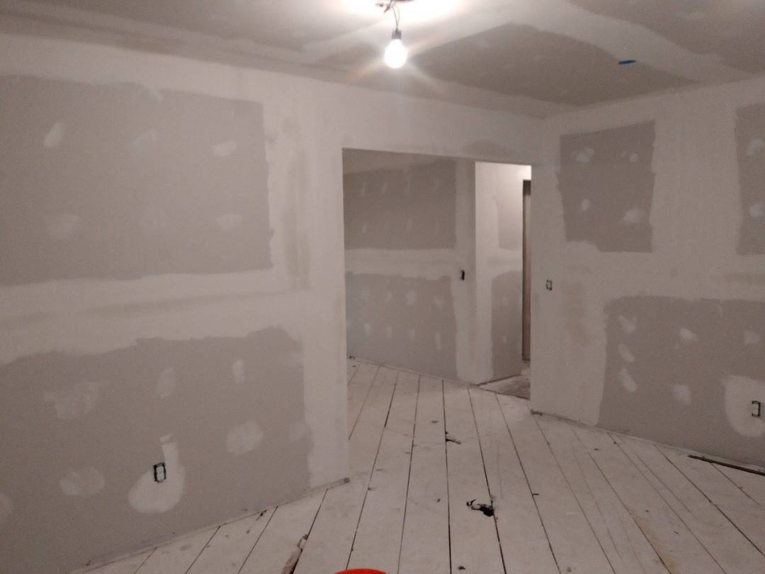 Grand Rapids, MI - Hard to tell, but I applied the second coat of mud. The ceilings in the bedrooms got 2 coats of ceiling paint and the trim work in the bedrooms recieved one coat of paint as well.