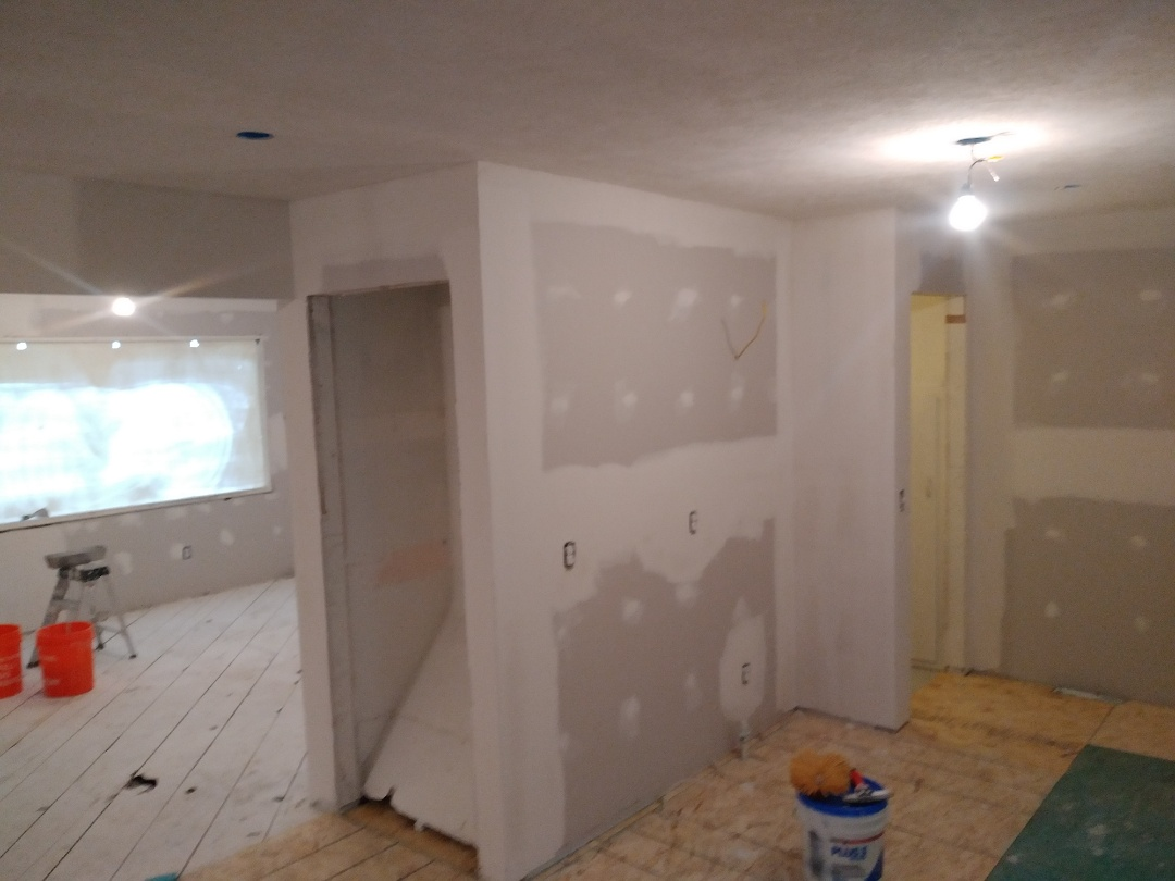 """Grand Rapids, MI - Applied the 3rd coat of mud. Textured the ceiling. Layed 1/2"""" plywood in the kitchen and dining rooms to accommodate future floor heights. Great pprogress today !"""