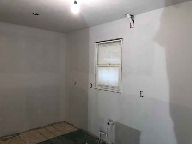 Grand Rapids, MI - This house had a small fire. Damage to walls and doors. Updated the drywall.