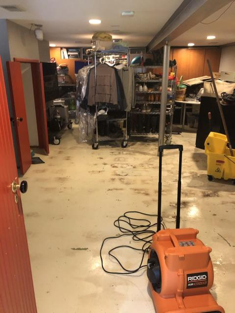 Rockford, IL - Flood coming in from the basement windows. Water damage on the basement floor.