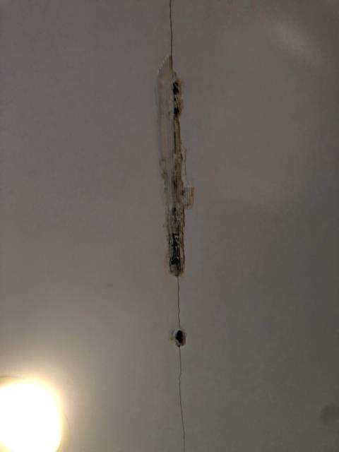 Grandville, MI - Water damage inspection. Toilet overflow from upstairs bathroom. Plaster damage to the living room ceiling on the main floor.