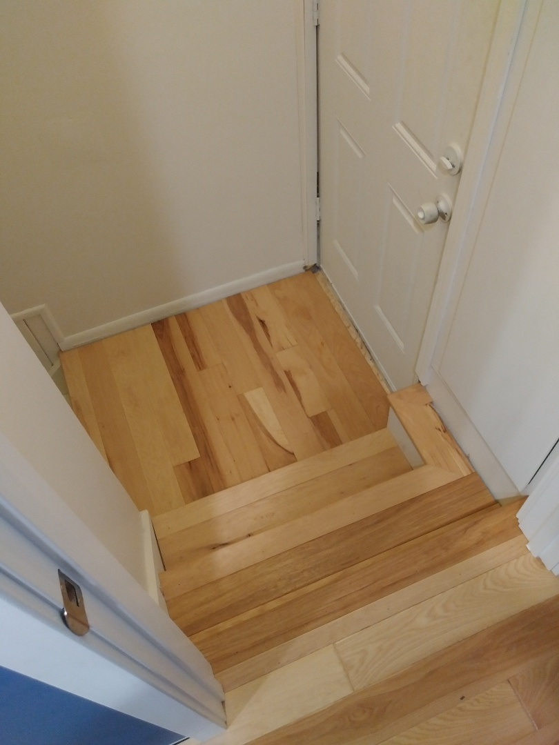 Grand Rapids, MI - Finished laying the new hickory floor in the landing and on the stairs