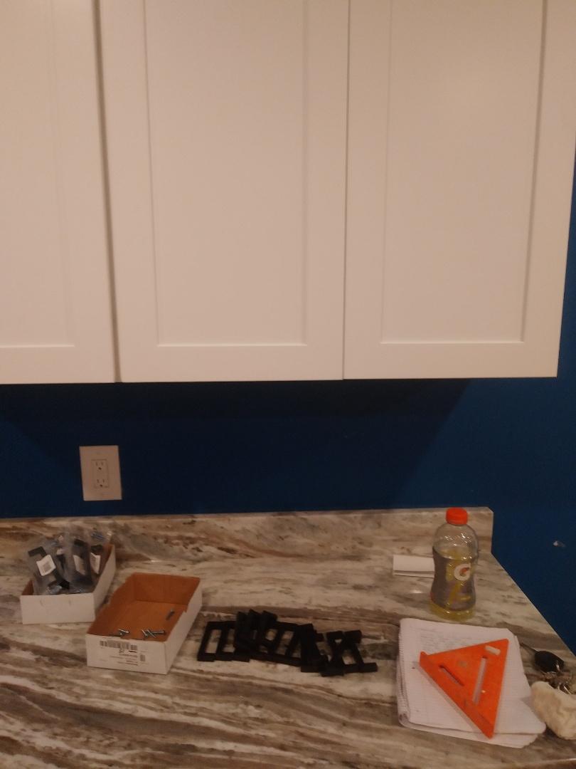 Walker, MI - Preparing to install cabinet hardware