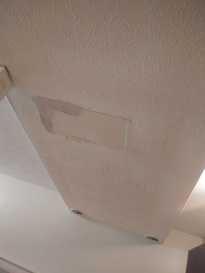 Rockford, MI -  A hole was cut in the ceiling to patch a leaking pipe. I replaced the jagged and damaged drywall and am applying the 1st coat of mud.
